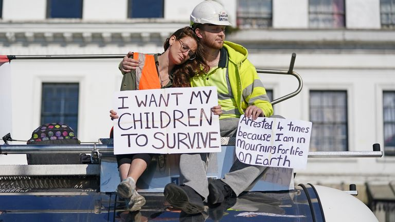 Protesters from Insulate Britain sit on top of a vehicle as they block the A20 in Kent, which provides access to the Port of Dover in Kent. The environmental activists have moved location after been banned from campaigning on the M25 motorway in London. Picture date: Friday September 24, 2021.