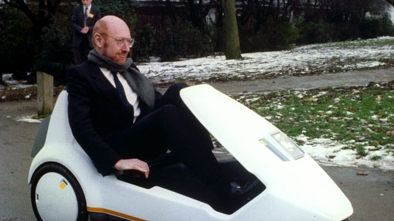 Sir Clive Sinclair demonstrates his battery-assisted pedal powered tricycle at Alexandra Palace, London, in 1985