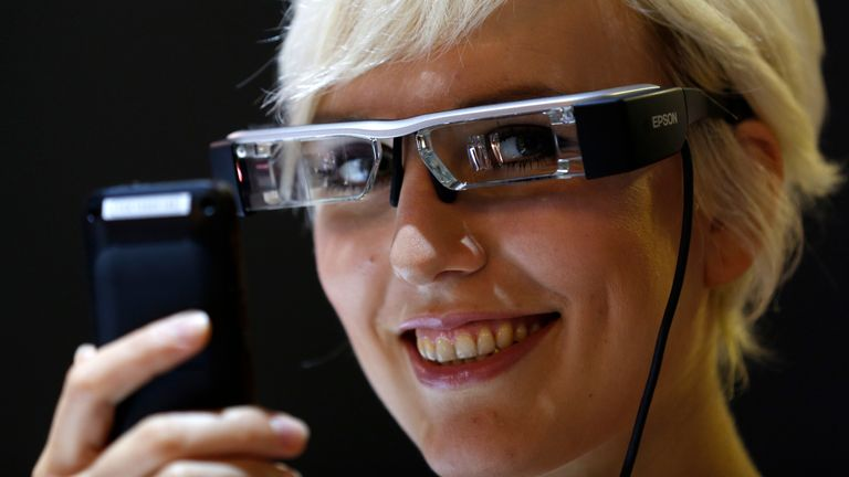 A model poses with 'Moverio BT-200' smart glasses of Epson on the media day of Photokina, the world's largest fair for imaging, in Cologne September 15, 2014. Each lens has its own display and is a premier development platform for apps of the future and hands-free scenarios, delivering large, 2D or 3D images. More than 1,000 exhibitors from 51 countries will show their latest products at the Photokina 2014 from September 16-21. REUTERS/Ina Fassbender (GERMANY - Tags: BUSINESS SCIENCE TECHNOLOGY
