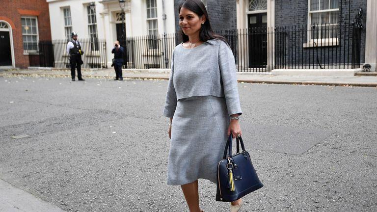 Britain's Home Secretary Priti Patel walks outside Downing Street in London, Britain, September 15, 2021. REUTERS/Hannah McKay