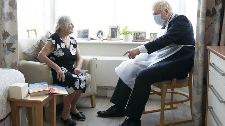 Prime Minister Boris Johnson talks to resident Kathleen during a visit to Westport Care Home in Stepney Green, east London, ahead of unveiling his long-awaited plan to fix the broken social care system. Picture date: Tuesday September 7, 2021. # Paul Edwards/The Sun/PA Wire/PA Images