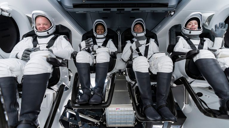 Chris Sembroski, Sian Proctor, Jared Isaacman and Hayley Arceneaux sit in the Dragon capsule