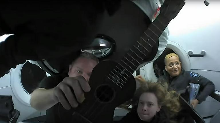 Chris Sembroski shows off his ukulele before his performance among the stars