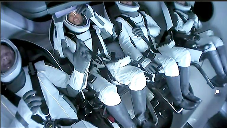 The passengers aboard a SpaceX capsule react as the capsule parachutes into the Atlantic. Pic: Inspiration4 via AP