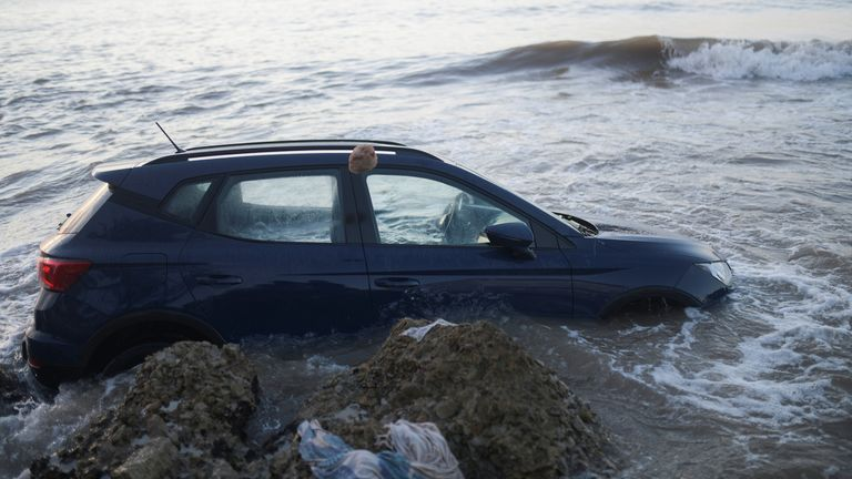 A car is seen in the sea after floods caused by heavy rains in Alcanar, Spain September 2, 2021
