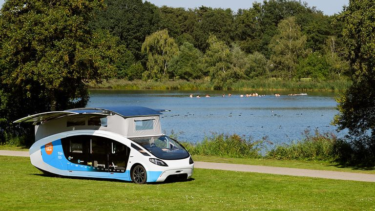 Stella Vita, the solar-powered driving house by students team Solar Team Eindhoven. With the roof folded out this Self-sustaining House On Wheels has 17,5 m2 of solar panels, enough for driving and living. On a full battery and a sunny day it could reach 730 kms.  Credit: STE / Bart van Overbeeke