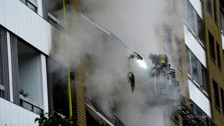 Emergency crews work to evacuate people from the building