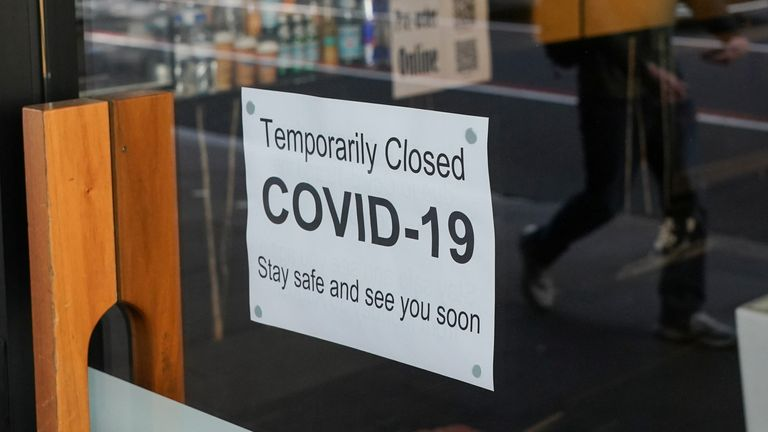 A sign is posted in a window during a lockdown to curb the spread of COVID in Sydney