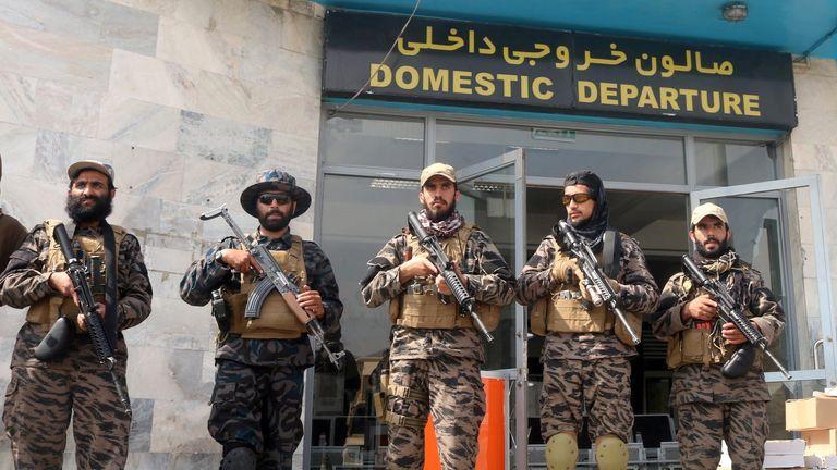 Taliban forces stand guard at Kabul airport