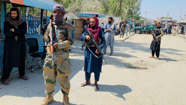 Taliban force stand guard, during an organised media tour to the Pakistan-Afghanistan crossing border, in Torkham, Pakistan