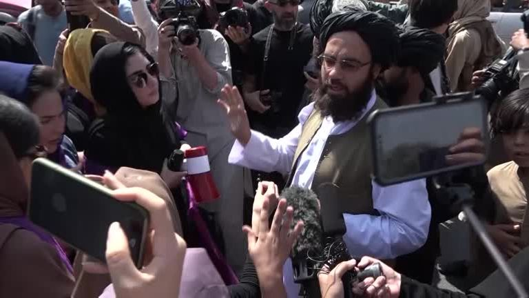 Members of the Taliban wade into crowds of protesting women in Kabul on Saturday