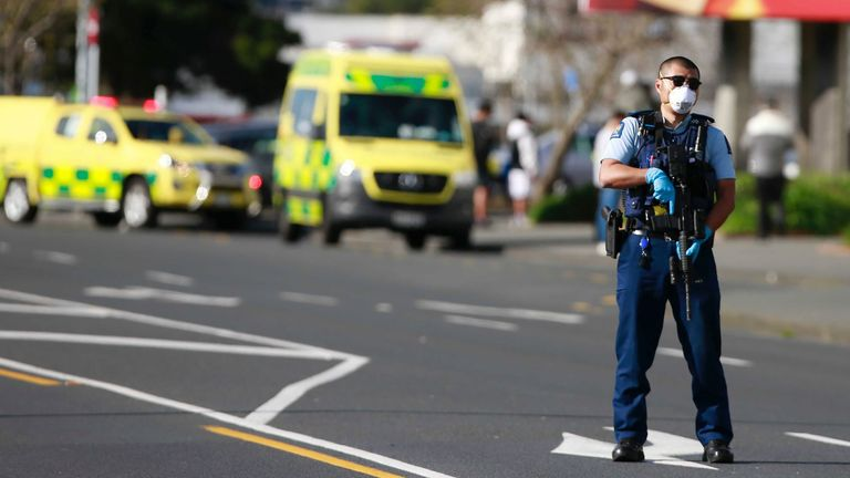 A police officer stands outside an Auckland supermarket -   New Zealand authorities said Friday they shot and killed a violent extremist after he entered a supermarket and stabbed and injured several shoppers. Prime Minister Jacinda Ardern described the incident as a terror attack.  PIC:New Zealand Herald/AP