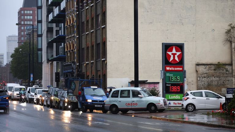 Vehicles queue to refill at a Texaco fuel station in London, Britain,