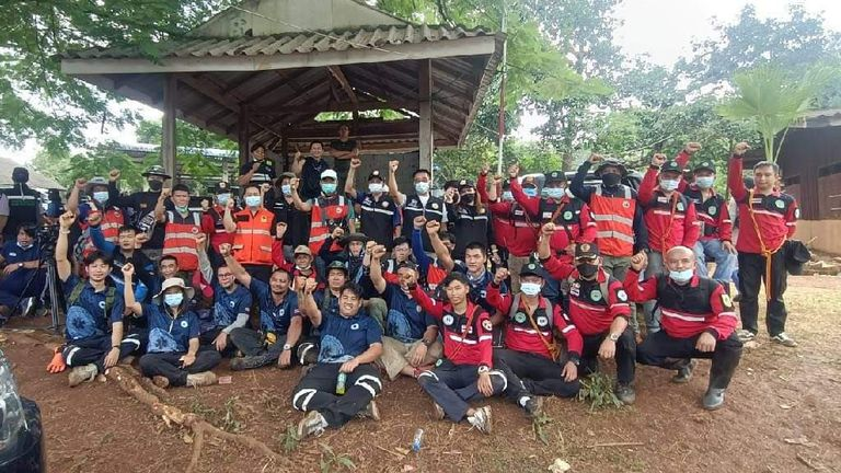 Search and rescue teams and volunteers celebrated finding missing toddler Gina in Thailand. Pic: Red Hawk Rescue Team, Maena Municipality.
