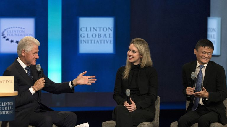 Former U.S. President Bill Clinton speaks with Jack Ma, executive chairman of Alibaba Group, and Elizabeth Holmes, CEO of Theranos, during the Clinton Global Initiative's annual meeting in New York