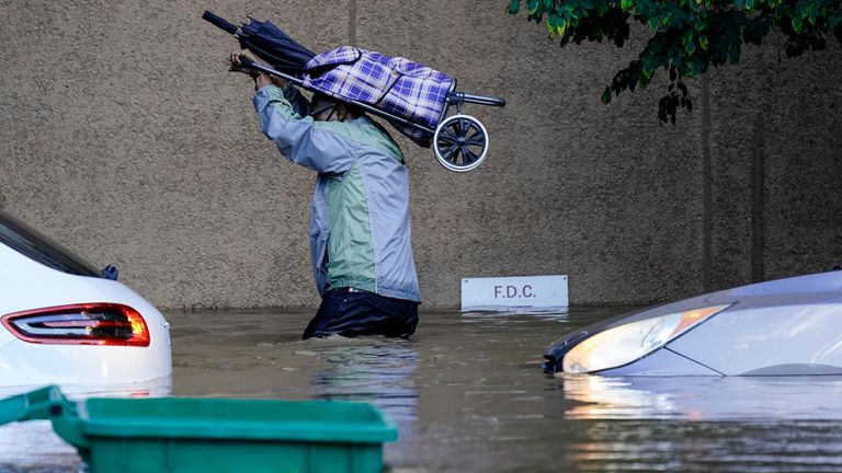 A person walks in floodwaters in Philadelphia, Thursday, Sept. 2, 2021 in the aftermath of downpours and high winds from the remnants of Hurricane Ida that hit the area. PIC:AP