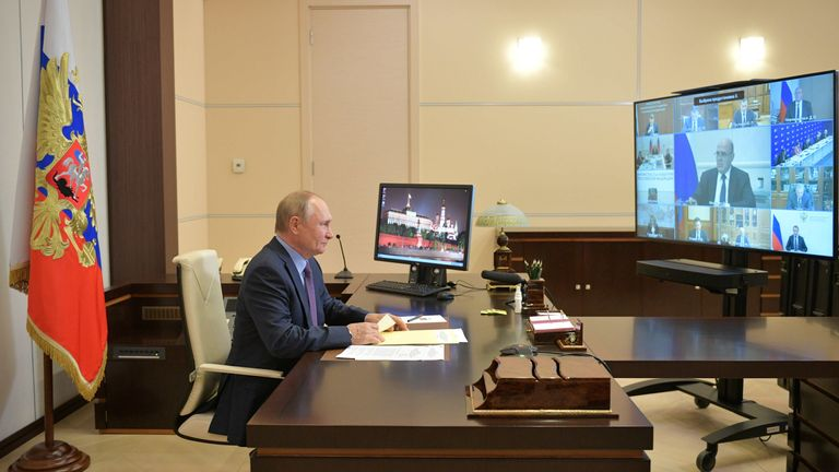 Russian President Vladimir Putin attends a meeting via a video link in Moscow