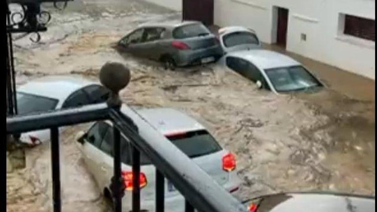 Taken with Permission - Flooding in Spain - cars underwater Caption Reads: El muro del CEIP Alonso Barba cayéndose. Imágenes de la C/Sevilla en Lepe (Huelva). Credit@ @JaviRd27