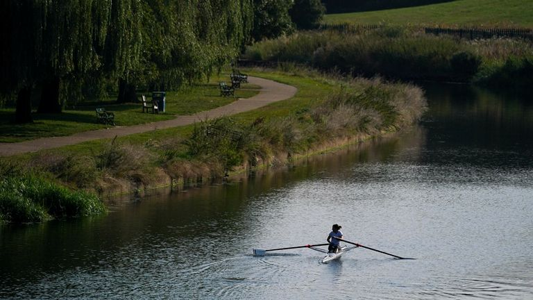 A rower makes the most of warm temperatures on the River Avon in Warwick on Sunday