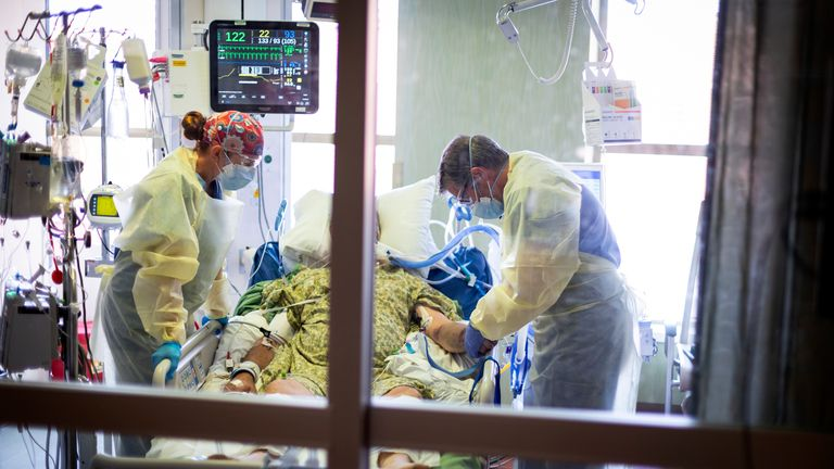 COVID-19 deaths in the US have surged to more than 1,900 a day - the highest level since early March Pic: AP