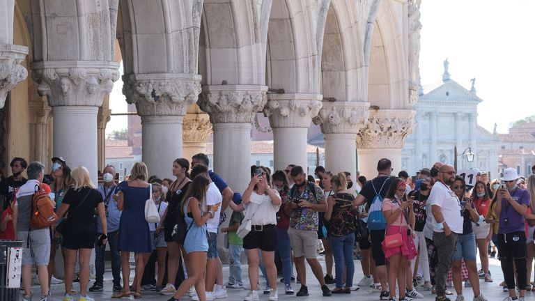 Tourists visit St. Mark's Square freely as the municipality prepares to charge them up to 10 Euro for entry into the lagoon city, in order to cut down the number of visitors, in Venice, Italy, September 5, 2021. Picture taken September 5, 2021. REUTERS/Manuel Silvestri
