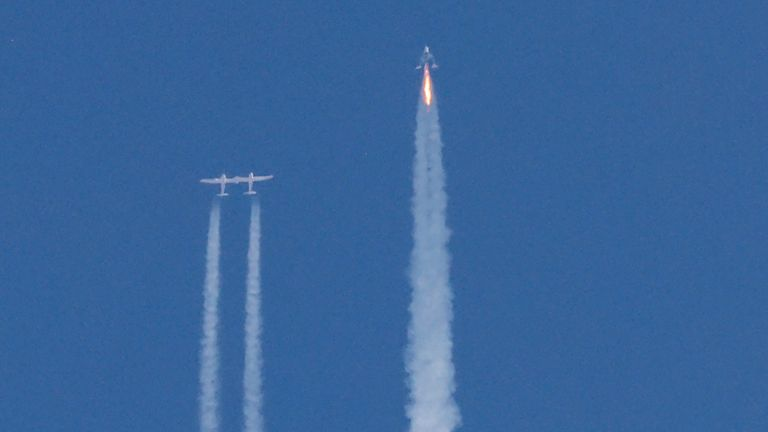 FILE PHOTO: Virgin Galactic's passenger rocket plane VSS Unity, carrying billionaire entrepreneur Richard Branson and his crew, begins its ascent to the edge of space above Spaceport America near Truth or Consequences, New Mexico, U.S., July 11, 2021. REUTERS/Joe Skipper/File Photo