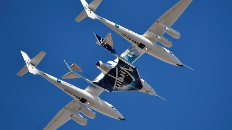 FILE PHOTO: Virgin Galactic rocket plane, the WhiteKnightTwo carrier airplane, with SpaceShipTwo passenger craft takes off from Mojave Air and Space Port in Mojave, California, U.S., February 22, 2019. REUTERS/Gene Blevins/File Photo