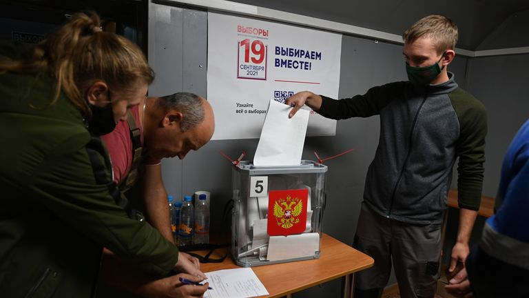 An oil worker casts his ballot during an early voting at the shift residential complex for oil production of Rosneft oil company in Uvat district of Tyumen region, 1891 km, (1181 miles) north-east of Moscow, Russia