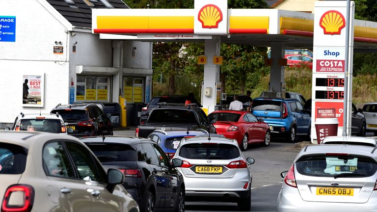 Cars queue up at a petrol and diesel filling station, Begelly, Pembrokeshire, Wales, Britain, September 24, 2021. REUTERS/Rebecca Naden