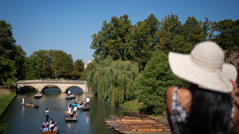 People make the most of the hot weather as they enjoy punt tours along the River Cam in Cambridge