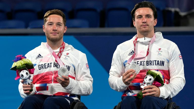 Britain's Alfie Hewett, left, and Gordon Reid pose with the silver medal during the victory ceremony of Wheelchair tennis men's doubles event at the Tokyo 2020 Paralympic Games, Friday, Sept. 3, 2021, in Tokyo, Japan. (AP Photo/Shuji Kajiyama)