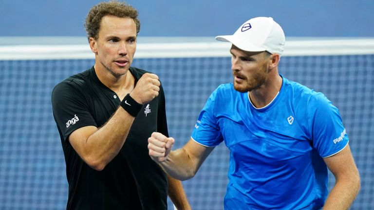 Bruno Soares high fives Jamie Murray during a Men's Doubles quarterfinal match at the 2021 US Open, Tuesday, Sep. 7, 2021 in Flushing, NY. (Manuela Davies/USTA via AP)