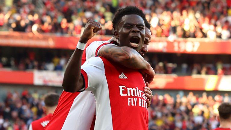 Bukayo Saka celebrates after making it 3-0