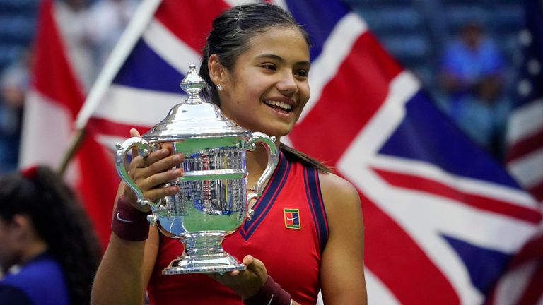 Emma Raducanu, of Britain, holds up the US Open championship trophy after defeating Leylah Fernandez, of Canada, during the women...s singles final of the US Open tennis championships, Saturday, Sept. 11, 2021, in New York. (AP Photo/Elise Amendola)