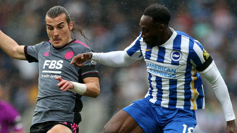 Leicester City's Caglar Soyuncu and Brighton and Hove Albion's Danny Welbeck battle for the ball