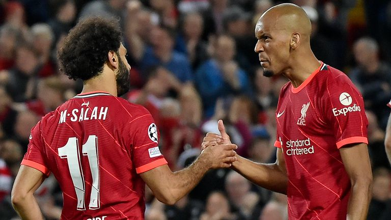 Mohamed Salah, left, celebrates with Fabinho after scoring Liverpool's second goal against AC Milan