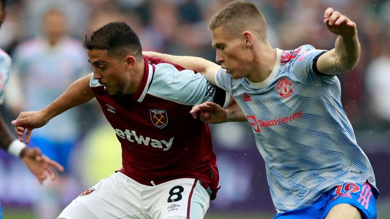Pablo Fornals and Scott McTominay battle for the ball