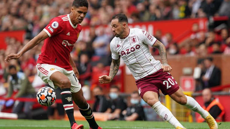 Manchester United's Raphael Varane and Aston Villa's Danny Ings battle for the ball