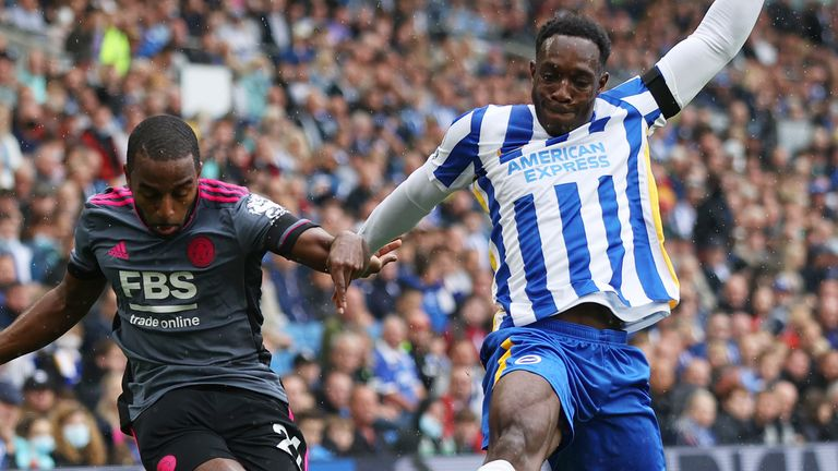 Ricardo Pereira crosses the ball while under pressure from Danny Welbeck during Brighton vs Leicester