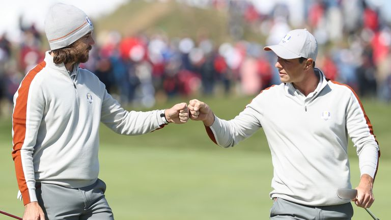 Tommy Fleetwood of England and team Europe (L) and Viktor Hovland of Norway and team Europe walk across the second green during Saturday Afternoon Fourball Matches of the 43rd Ryder Cup at Whistling Straits