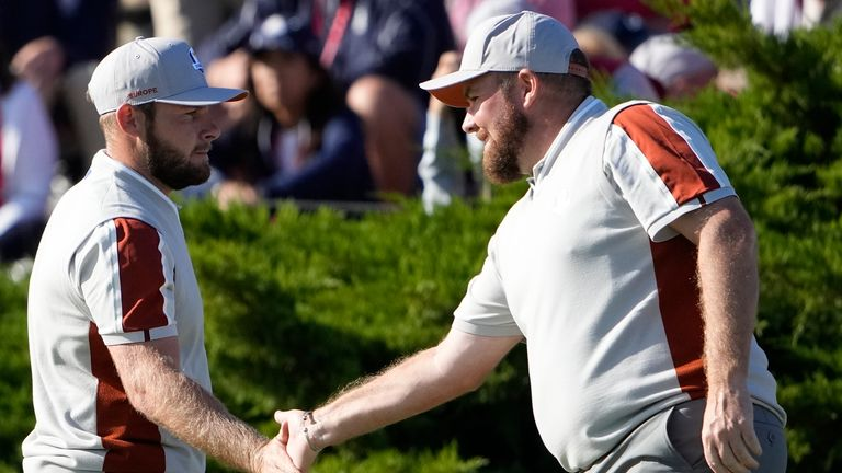 Team Europe's Shane Lowry and Team Europe's Tyrrell Hatton react on the 11th hole during a four-ball match the Ryder Cup at the Whistling Straits Golf Course Saturday, Sept. 25, 2021, in Sheboygan, Wis. (AP Photo/Jeff Roberson)