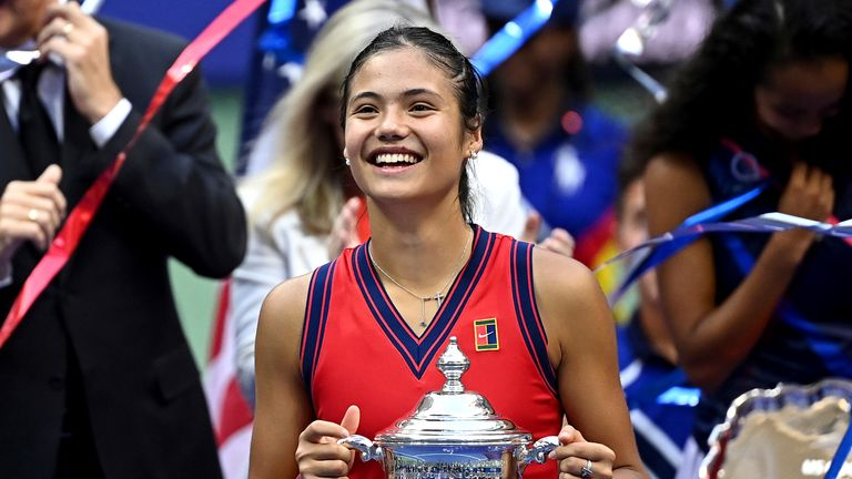 Emma Raducanu poses with the US Open trophy after her historic win