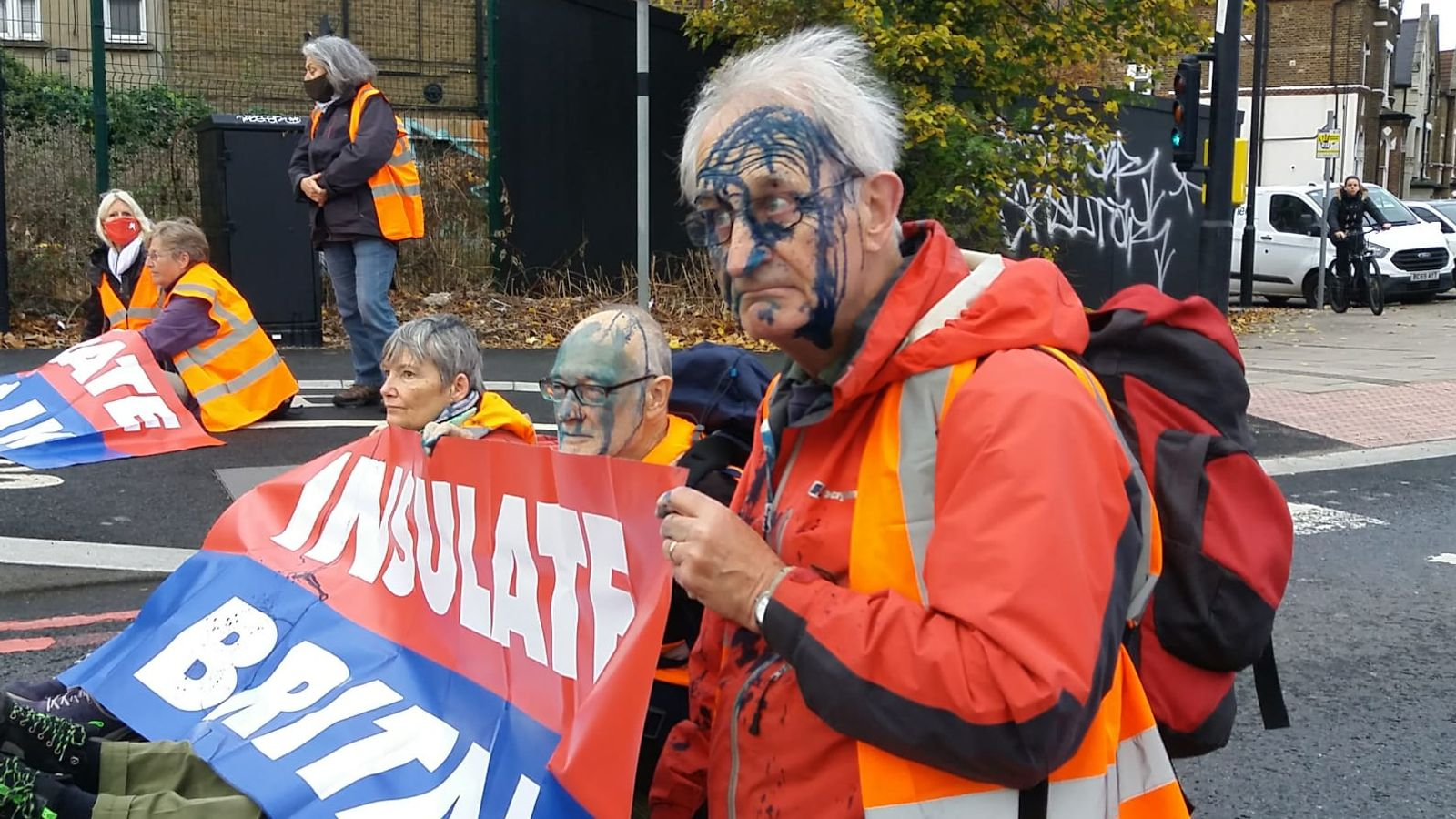 Insulate Britain protesters have ink thrown on them as they block roads in Dartford and west London