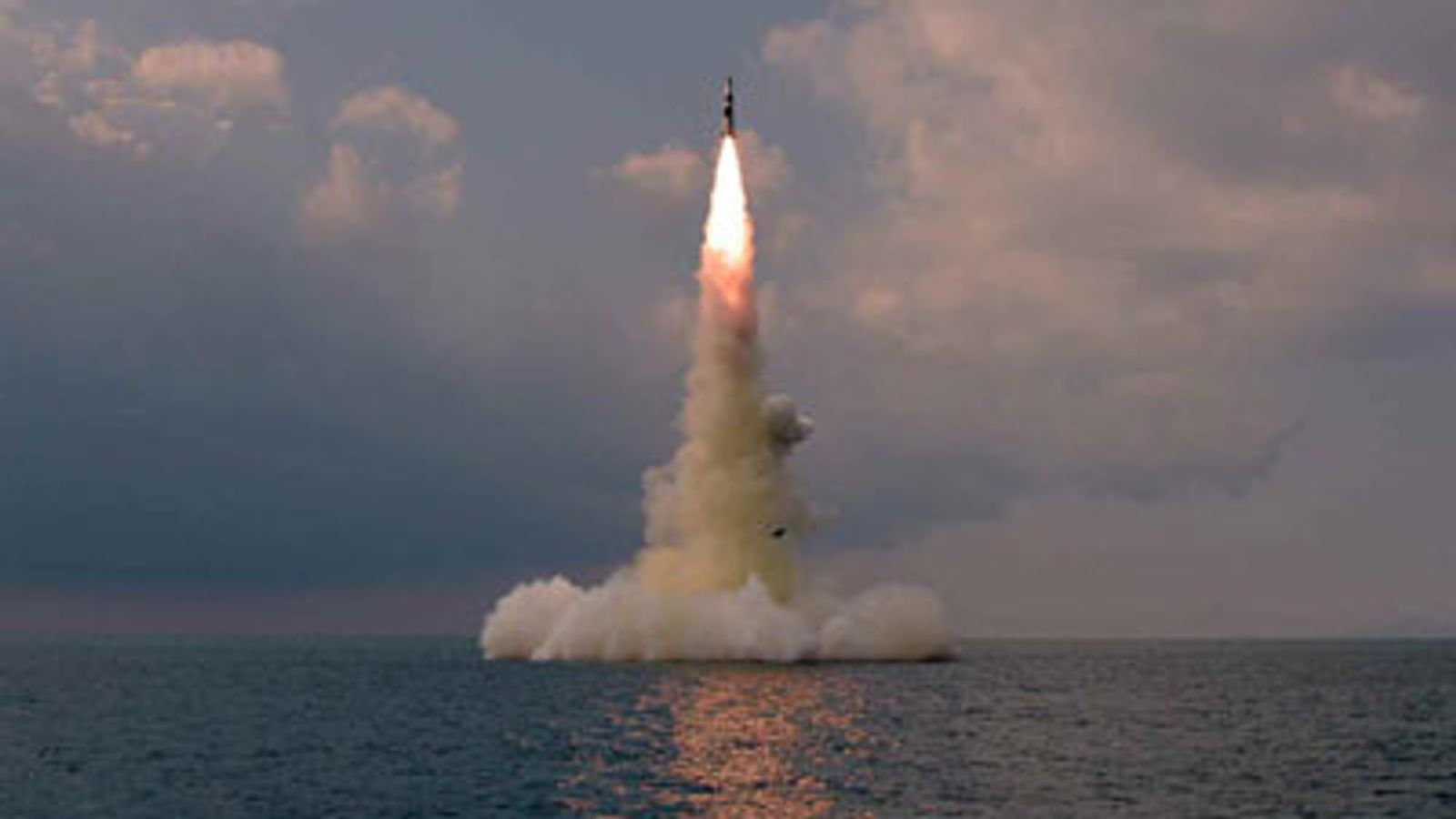 North Korea test-fires 'new ballistic missile' from submarine