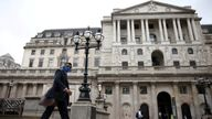 person walks past the Bank of England in the City