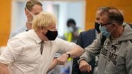British Prime Minister Boris Johnson greets members of the public as he visits a COVID-19 vaccination centre at Little Venice Sports Centre, in London, Friday, Oct. 22, 2021. (AP Photo/Matt Dunham, Pool) PIC:AP