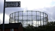 FILE PHOTO: A disused gas holder is seen behind a road sign for Energy Street in Manchester, Britain, September 23, 2021. REUTERS/Phil Noble/File Photo