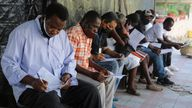 People register for the Moderna vaccine in Haiti where doses were donated by the US through the UN's COVAX system