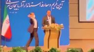 Moment Iranian official is slapped on stage