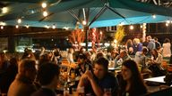 People gather at Las Iguanas restaurant and bar on Southbank in London. September 2020